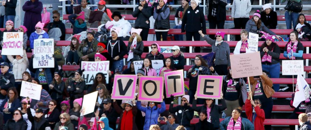 """PHOTO: Attendees stand during the Womens March Anniversary """"Power To The Polls"""" event, Jan. 21, 2018, at Sam Boyd Stadium in Las Vegas."""