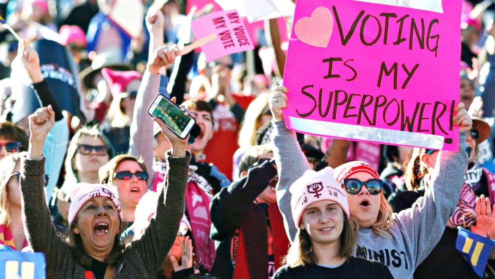 """People cheer a speaker during the Women's March """"Power to the Polls"""" voter registration tour launch at Sam Boyd Stadium on Jan. 21, 2018, in Las Vegas."""