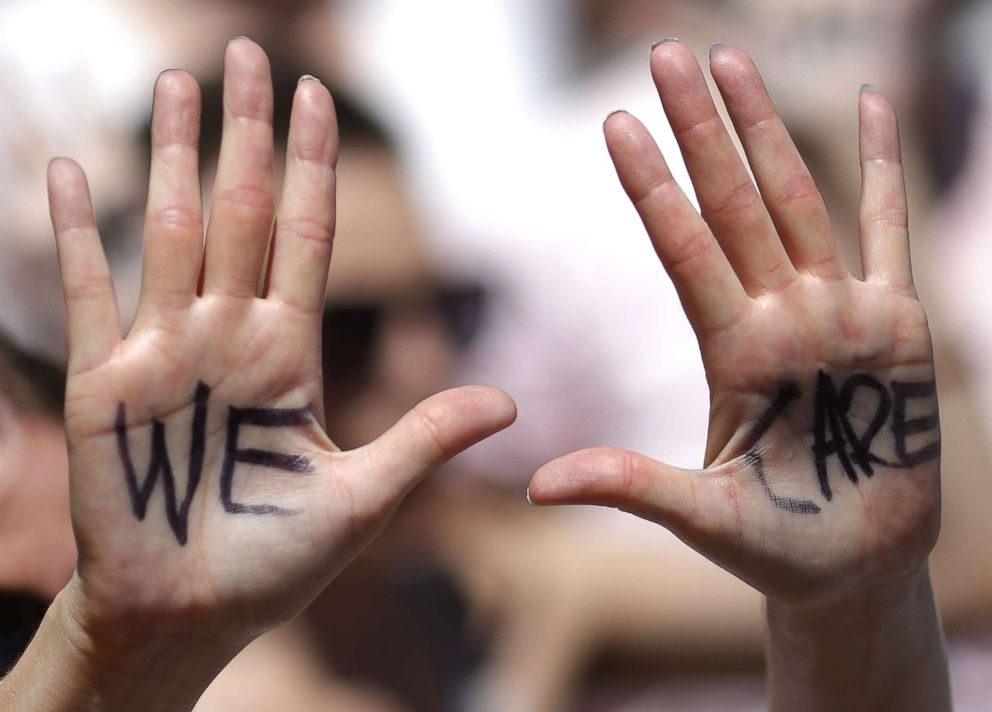 PHOTO: We Care is written on a protesters hands during a march from Freedom Plaza to demonstrate against family detentions and to demand the end of criminalizing efforts of asylum seekers and immigrants June 28, 2018 in Washington, D.C.