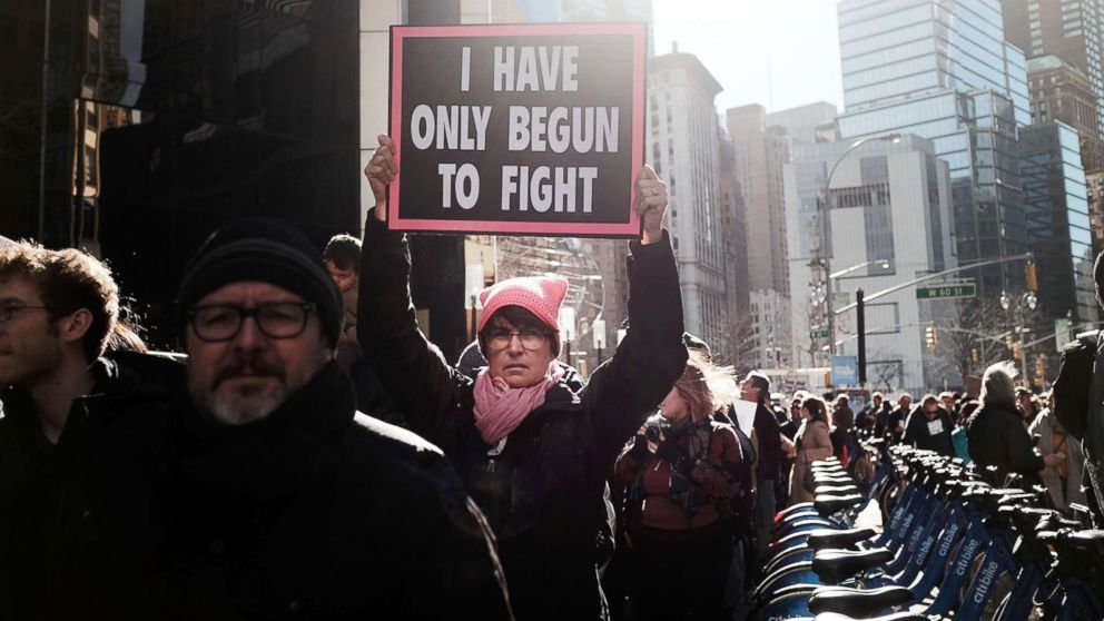 Thousands of men and women hold signs and rally while attending the Women's March, Jan. 20, 2018 in New York.