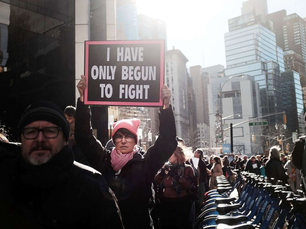 PHOTO: Thousands of men and women hold signs and rally while attending the Womens March, Jan. 20, 2018 in New York.