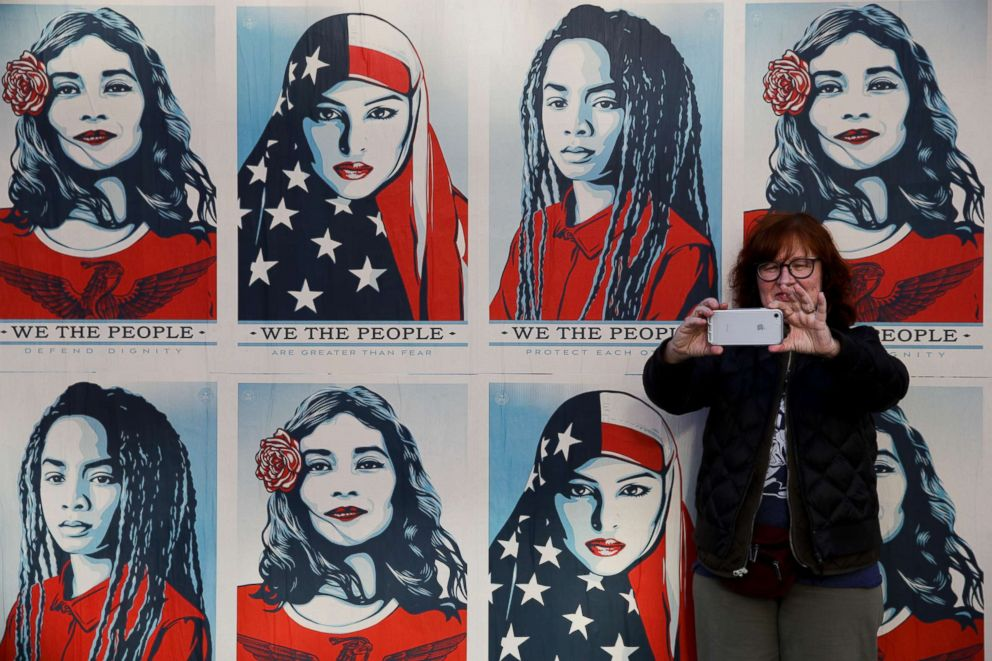 PHOTO: A participant takes a selfie in front of posters supporting womens rights during a Womens March in Los Angeles, Jan. 20, 2018.