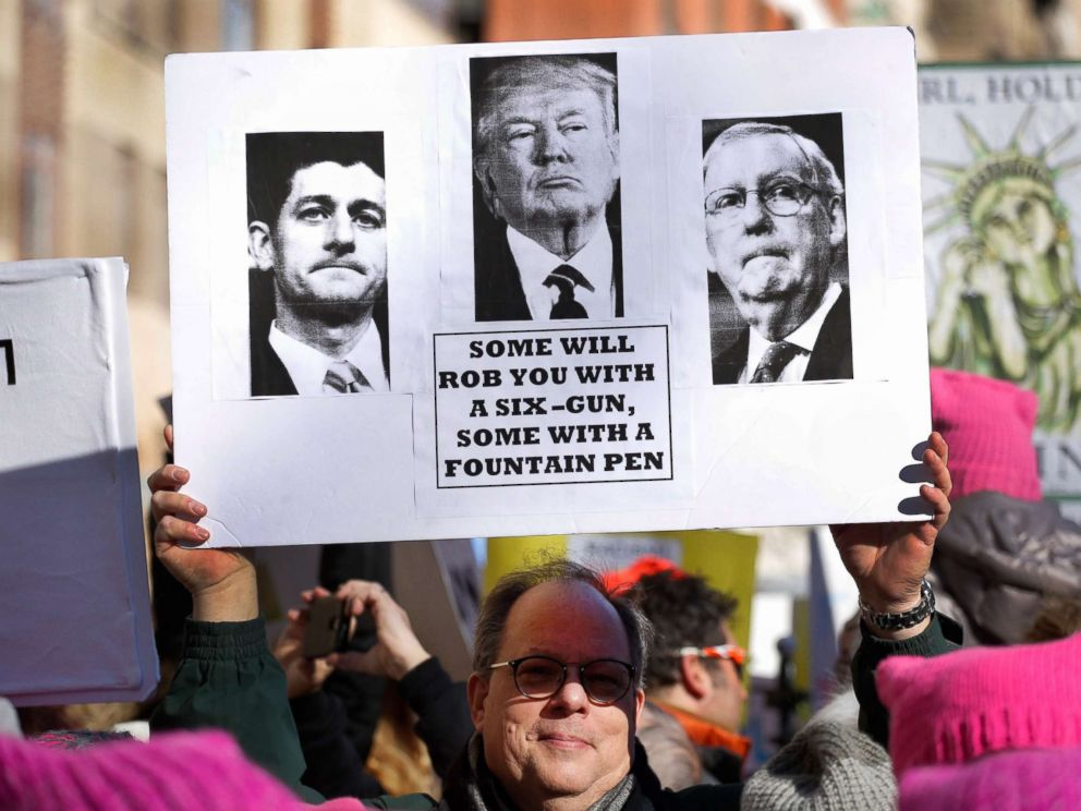 PHOTO: A man holds a sign as he attends the Womens March, Jan. 20, 2018 in New York City.