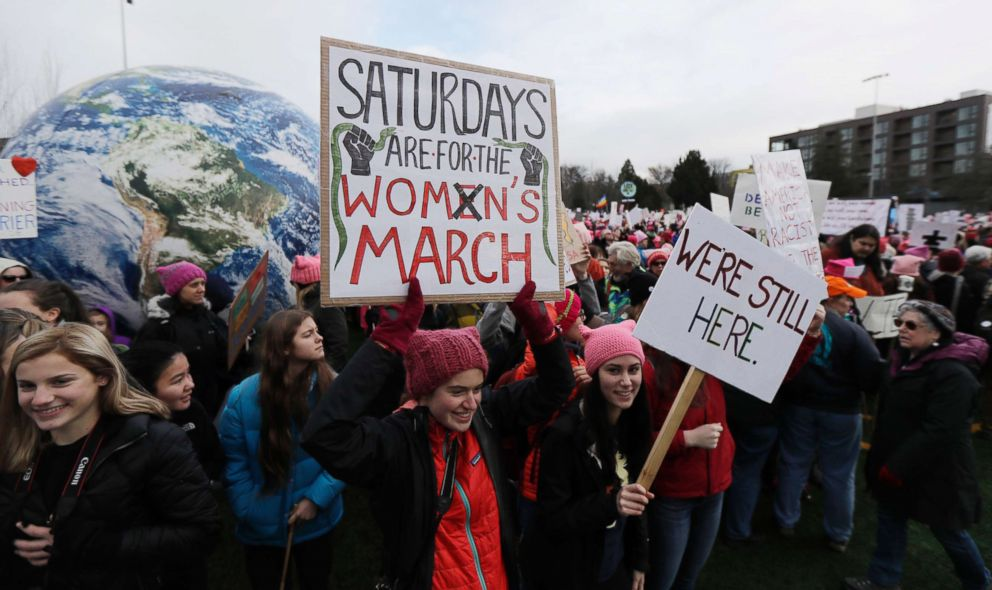PHOTO: A woman holds as sign as she takes part in a Womens March in Seattle, Jan. 20, 2018.