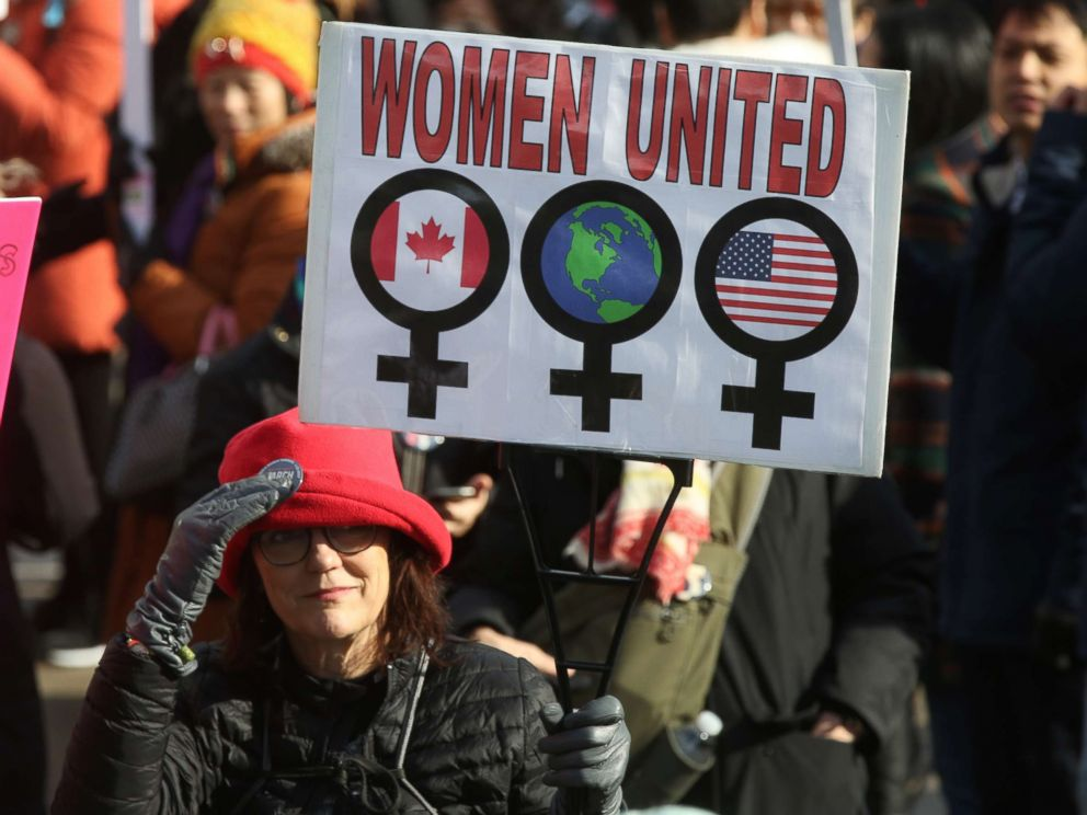PHOTO: Woman holding a sign saying Women United as hundreds take part in the Womens March in downtown Toronto, Canada, Jan. 20, 2018.