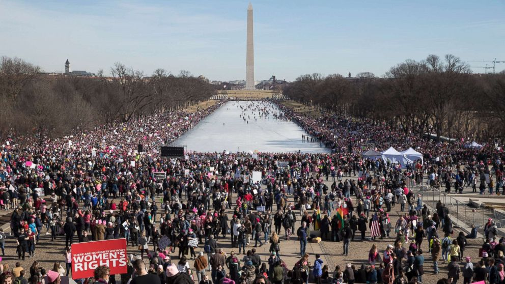 Thousands of people participate in the Women's March, beside the Lincoln Memorial Reflecting Pool in Washington, D.C., Jan. 20, 2018.