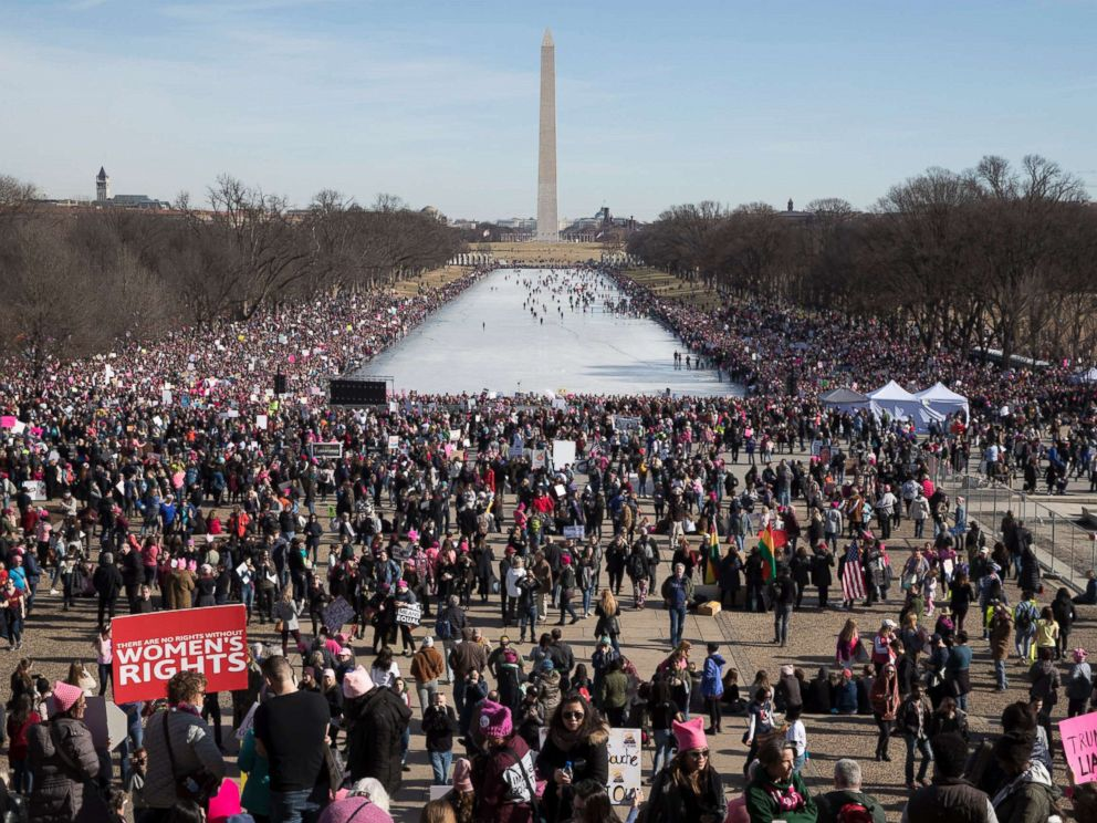PHOTO: Thousands of people participate in the Womens March, beside the Lincoln Memorial Reflecting Pool in Washington, D.C., Jan. 20, 2018.