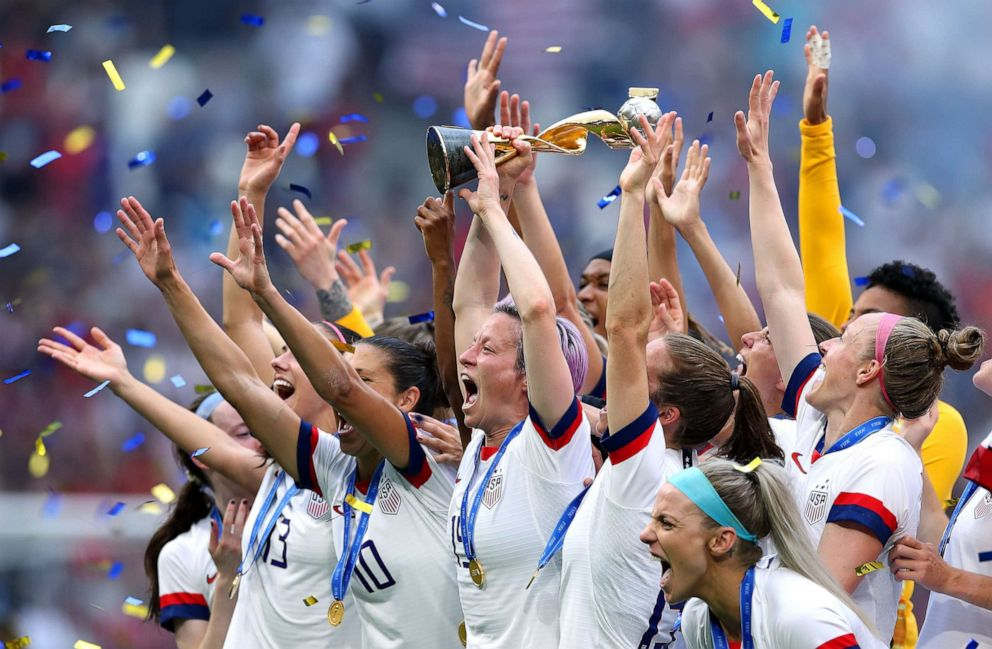 PHOTO: Megan Rapinoe lifts the FIFA Womens World Cup Trophy following her teams victory in the 2019 FIFA Womens World Cup France Final match between USA and The Netherlands at Stade de Lyon on July 7, 2019 in Lyon, France.