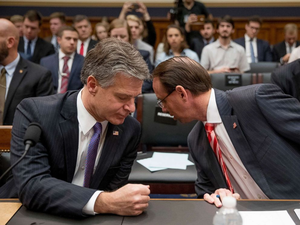 PHOTO: FBI Director Christopher Wray, left, speaks with Deputy Attorney General Rod Rosenstein during the start of the hearing on the Justice Department and FBI actions around the 2016 presidential election, June 28, 2018, in Washington, D.C.