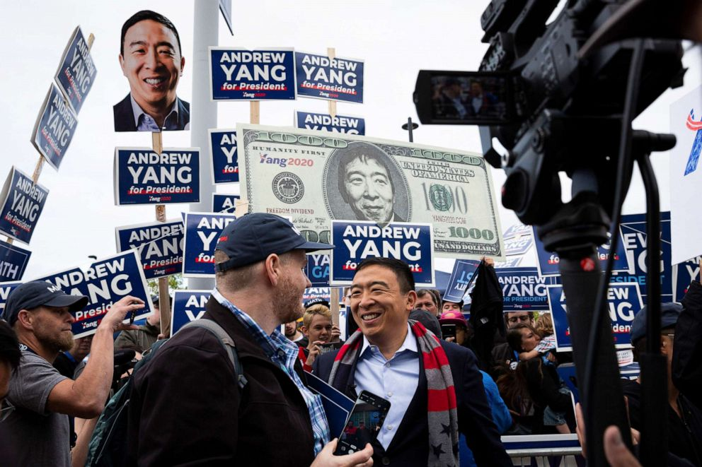 PHOTO: Andrew Yang with supporters outside the New Hampshire Democratic Party State Convention in Manchester, N.H., on Sept. 7, 2019.