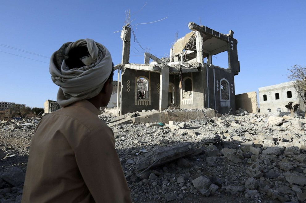 PHOTO: A Yemeni man sits in front of a building allegedly destroyed by recent airstrikes in Sanaa, Yemen, March 25, 2018.