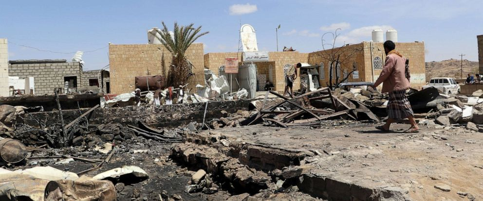 PHOTO: A man walks at the scene of an air strike that hit a gas station near a hospital in Kutaf district of the northwestern province of Saada, Yemen, March 28, 2019.