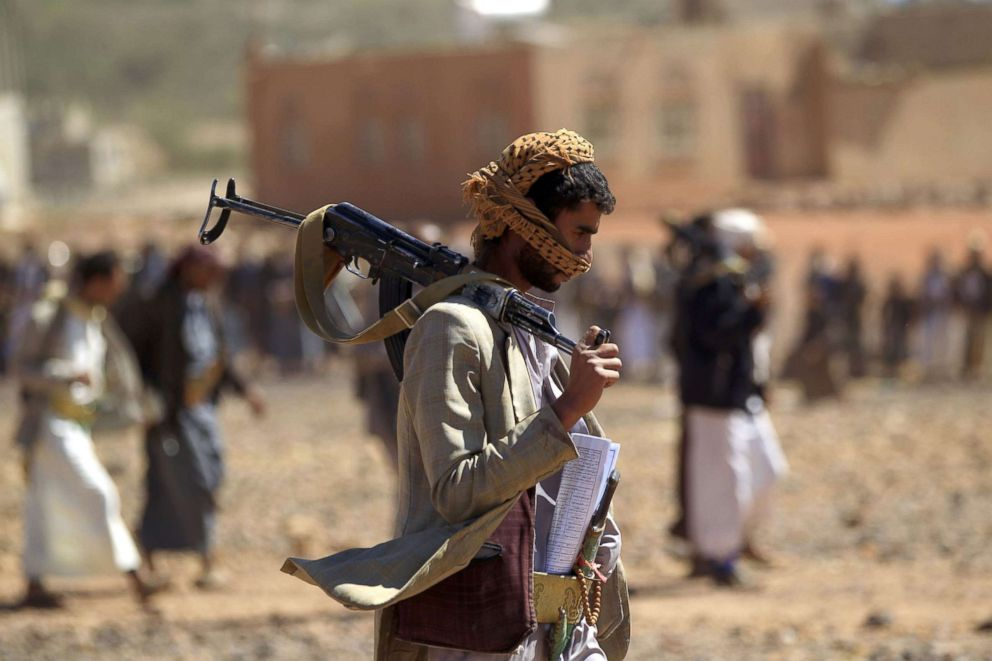 PHOTO: A Yemeni man carries a Kalashnikov rifle as he takes part in a gathering near Sanaa, to show support to the Shiite Huthi movement against the Saudi-led intervention, Feb. 21, 2019.