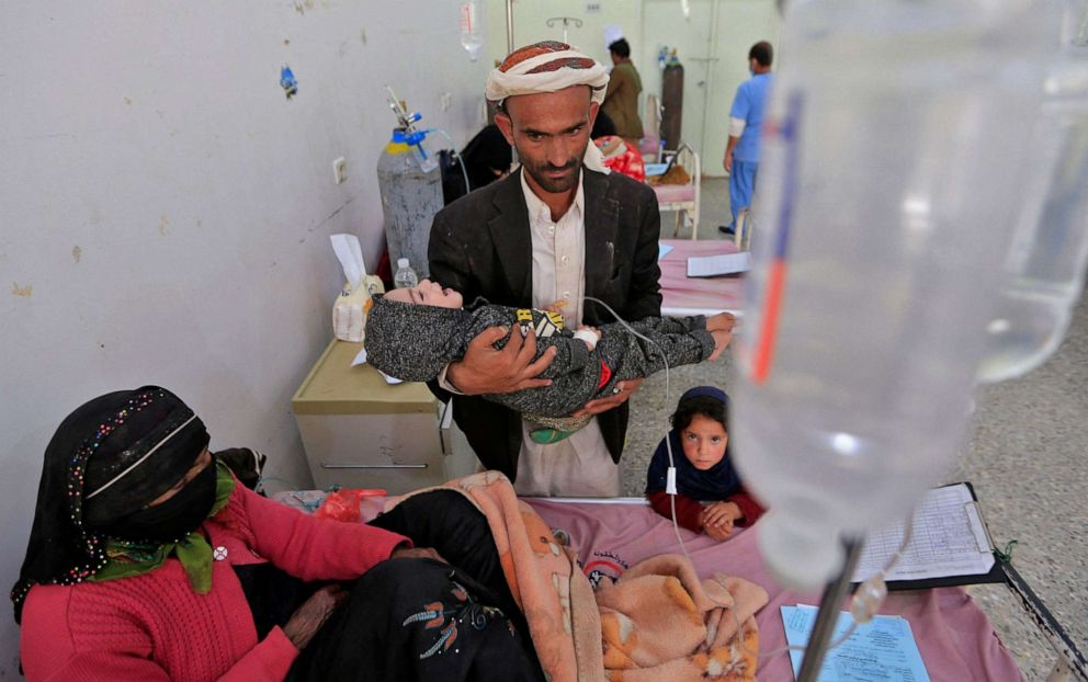 PHOTO: A Yemeni father carries his malnourished child at al-Sabeen Maternity and Child Hospital in the Huthi-rebel-held Yemeni capital Sanaa, on March 2, 2021.