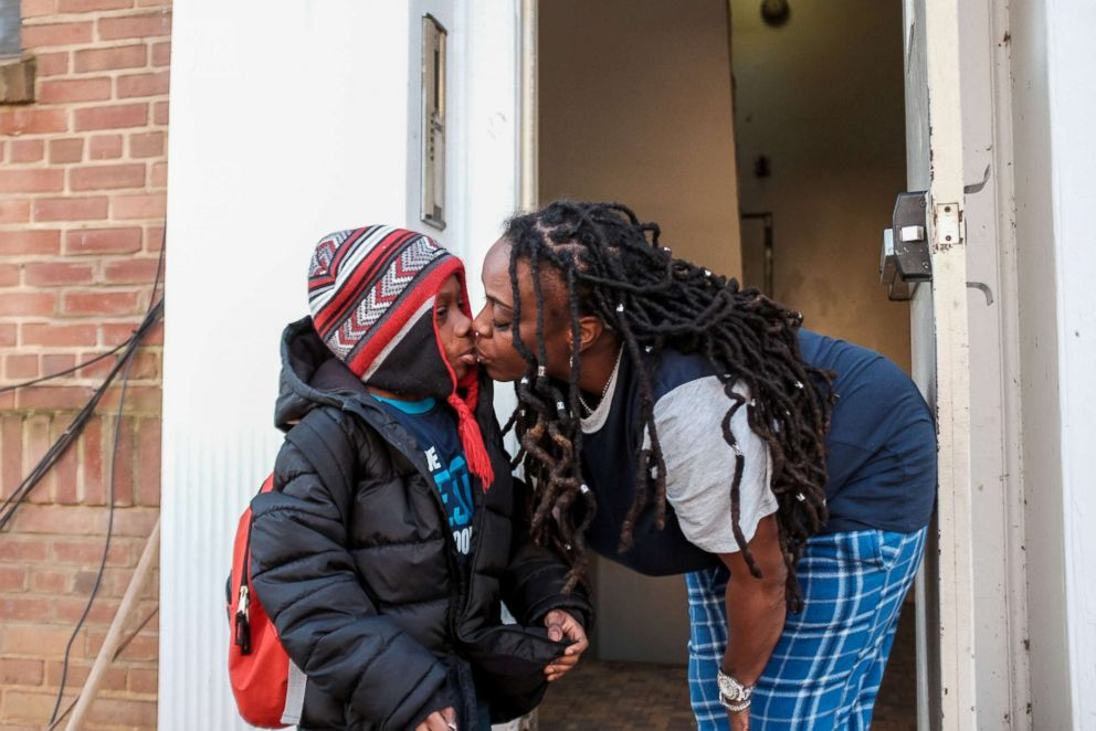 PHOTO: U.S. federal government contractor Yvette Hicks gives her son a kiss goodbye as he heads to school on the 35th day of the partial federal government shutdown in Washington, Jan. 25, 2019.