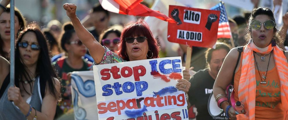 "PHOTO: Critics of the U.S. policy which separates children their parents when they cross the border illegally from Mexico protest during a ""Families Belong Together March"" in downtown Los Angeles, June 14, 2018."
