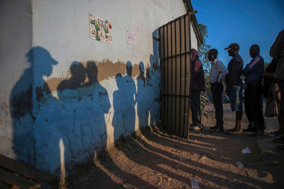 PHOTO: Voters queue to cast their votes at a polling station in Harare, Zimbabwe, Monday July 30, 2018.