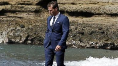 """PHOTO: Juan Pablo Galavis walks along the beach during the season finale of """"The Bachelor."""" During the episode, which aired March 10, 2014, he was forced to choose between two women, Clare and Nikki."""