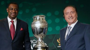 PHOTO: CONCACAF president Jeffrey Webb, left, and Eugenio Figueredo, right, president of CONMEBOL, the South American soccer Confederation, pose next to the 2016 Copa America trophy in Bal Harbour, Fla. on May 1, 2014.