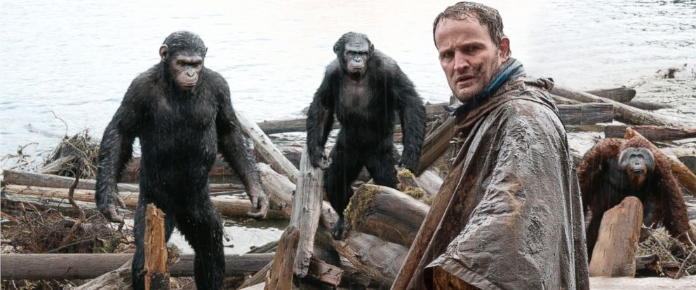 """PHOTO: Jason Clarke, as Malcolm, foreground, and, Andy Serkis, as Caesar; Toby Kebbell, as Koba; and Karin Konoval, as Maurice; in a scene from the film, """"Dawn of the Planet of the Apes."""""""