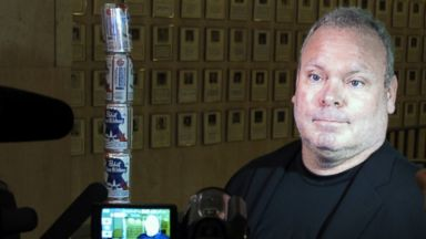 PHOTO: Chaz Stevens talks with reporters after setting up his Festivus pole made out of beer cans at the Florida Capitol building in Tallahassee, Fla., Dec. 11, 2013.