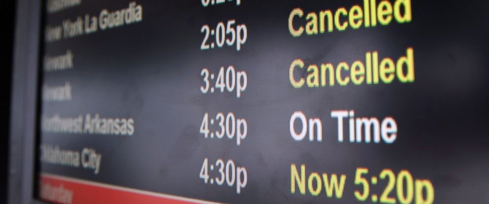 PHOTO: A screen displays flight status information at OHare International Airport in Chicago, Feb. 1, 2014.