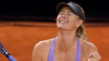 PHOTO: Russias Maria Sharapova celebrates after defeating Serbias Ana Ivanovic with 3-6, 6-4 and 6-1 in their final match at the Porsche tennis Grand Prix in Stuttgart, Germany, April 27, 2014.