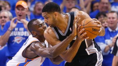 PHOTO: Oklahoma City Thunder forward Serge Ibaka reaches in to try and take the ball away from San Antonio Spurs forward Tim Duncan at he Western Conference finals NBA basketball playoff series in Oklahoma City, May 27, 2014.