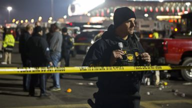 PHOTO: Kansas City, Mo. police officers and detectives examined a crime scene where one person died in Lot A of the Truman Sports Complex at Arrowhead Stadium in Kansas City, Mo., Dec. 1, 2013.