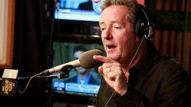 PHOTO: Piers Morgan visits The Opie & Anthony Show at SiriusXM Studios, Oct. 16, 2013 in New York.