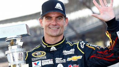 PHOTO: Jeff Gordon celebrates with his trophy after the NASCAR Sprint Cup Series Crown Royal Presents The John Wayne Walding 400 at the Brickyard Indianapolis Motor Speedway on July 27, 2014 in Indianapolis, Ind.