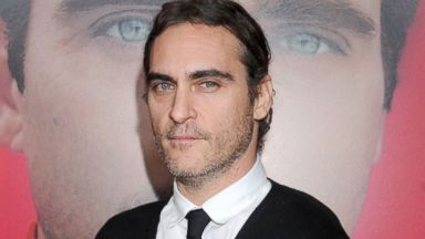 "PHOTO: Joaquin Phoenix arrives at the Los Angeles premiere of ""Her"" at Directors Guild Of America, Dec. 12, 2013, in Los Angeles."