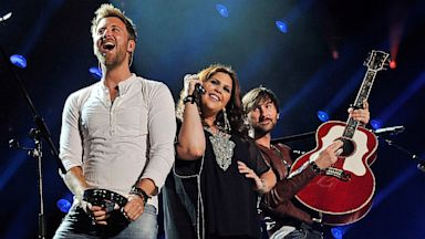 PHOTO: Charles Kelley, Hillary Scott, and Dave Haywood of the band Lady Antebellum perform at LP Field during the 2013 CMA Music Festival on June 7, 2013, in Nashville, Tenn.
