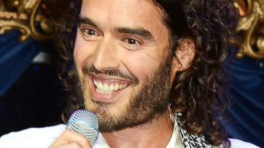 PHOTO: Russell Brand performs at The Hoping Foundations Starry Starry Night Benefit Evening for Palestinian Refugee Children at Cafe de Paris, June 19, 2014, in London.