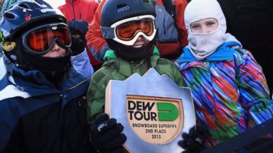 PHOTO: Snowboard fan Connor Tripp shows off the trophy that Shaun White gave him at the Dew Tour iON Mountain Championships in Breckenridge, Colorado, Dec. 14, 2013.