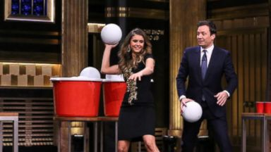 PHOTO: Actress Nina Dobrev plays giant beer pong with host Jimmy Fallon on The Tonight Show Starring Jimmy Fallon, Aug. 5, 2014.