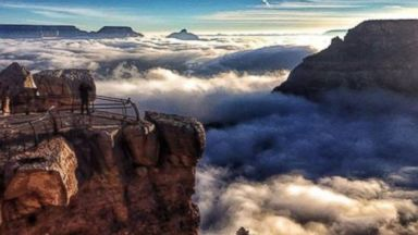 """PHOTO: A picture of the Grand Canyon during an """"inversion,"""" where clouds fill the canyon"""