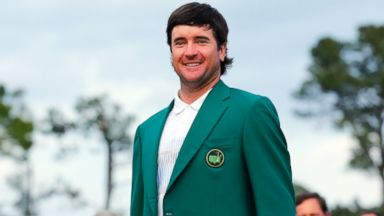 PHOTO: Masters winner Bubba Watson stands in his green jacket after winning the Masters golf tournament at the Augusta National Golf Club in Augusta, Ga., April 13, 2014.
