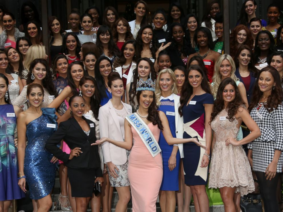 PHOTO: Miss World 2013 Winner Megan Young, centre arms outstretched, poses for photographs with Miss World Contestants in London, Nov. 25, 2014.
