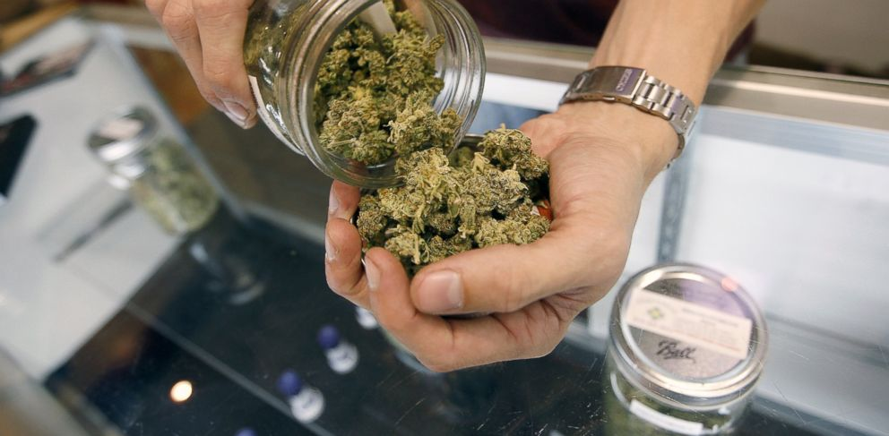 David McNew/Getty ImagesPHOTO: An employee pours marijuana buds from a jar at Perennial Holistic Wellness Center, a medical marijuana dispensary in Los Angeles, July 25, 2012.