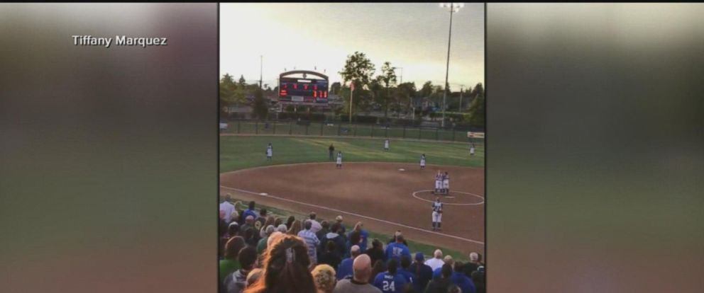 When the crowd attending a high school softball game heard the national anthem wouldnt be played, they reported booed and stood up and sung the song anyway.