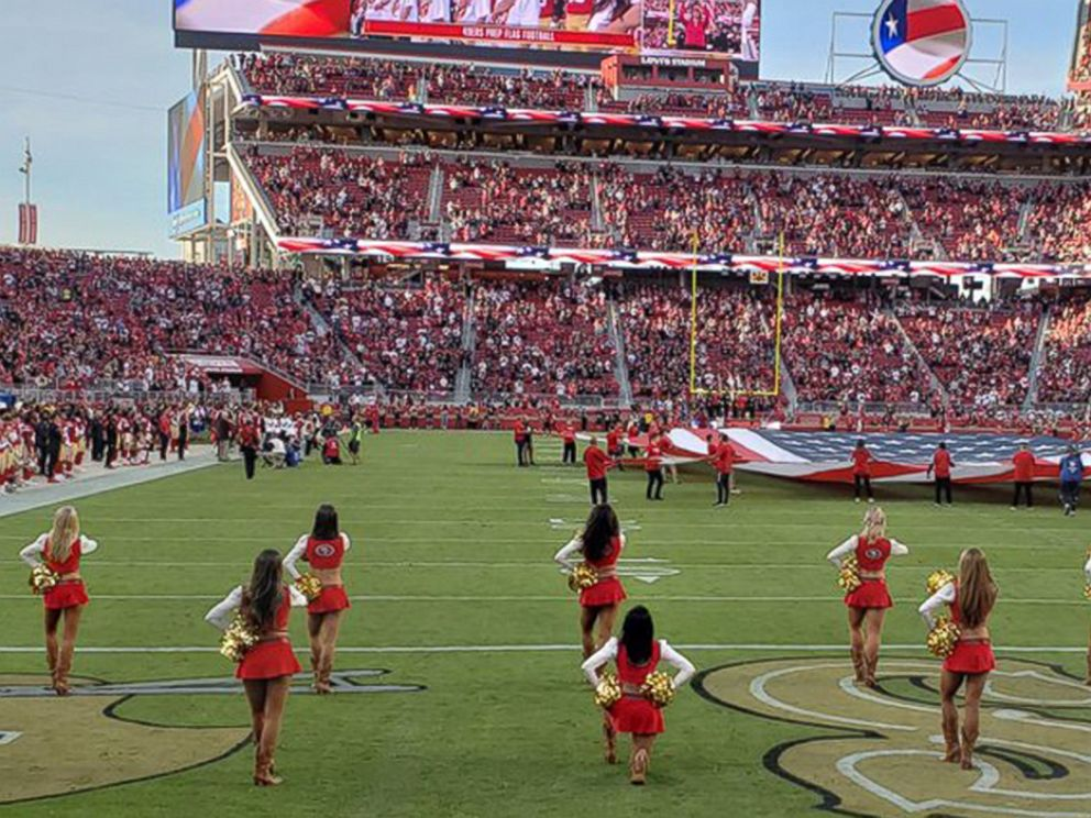PHOTO: A San Francisco 49ers cheerleader is seen kneeling during the national anthem ahead of the teams game against the Oakland Raiders on Nov. 1, 2018.
