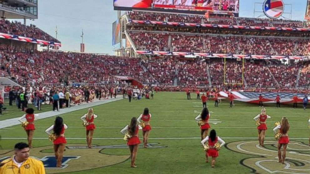 A 49ers cheerleader knelt during the national anthem during the Raiders  game. 7c032473a