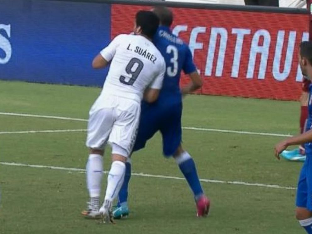 PHOTO: Luis Suarez appears to bite Giorgio Chiellini during the 2014 World Cup on June 24, 2014 in Brazil.