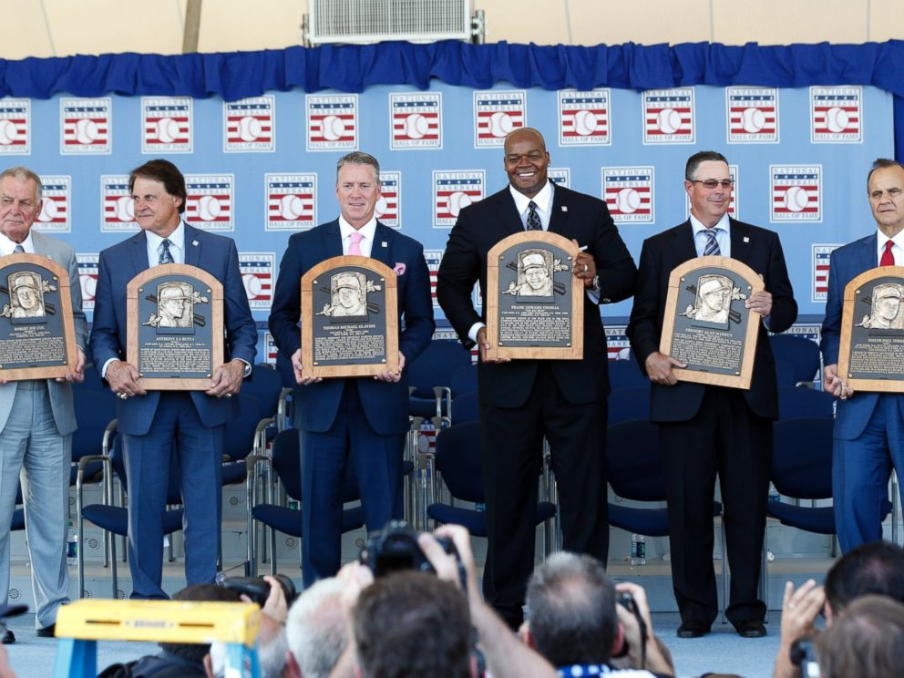 PHOTO: National Baseball Hall of Fame inductees, from left, Bobby Cox, Tony La Russa, Tom Glavine, Frank Thomas, Greg Maddux and Joe Torre hold their plaques after their induction ceremony, July 27, 2014, in Cooperstown, N.Y.