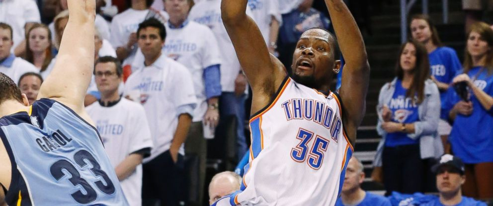 PHOTO: Oklahoma City Thunder forward Kevin Durant releases an off-balance shot after being fouled by Memphis Grizzlies center Marc Gasol during an NBA playoff game, April 21, 2014.