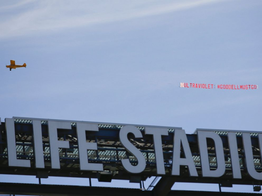 PHOTO: A plane pulls a banner over MetLife Stadium while teams warm up before an NFL football game between the New York Giants and the Arizona Cardinals, Sept. 14, 2014, in East Rutherford, N.J.