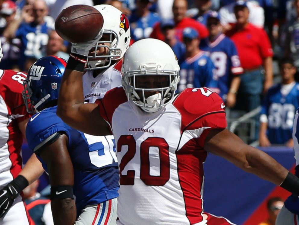 Arizona Cardinals running back Jonathan Dwyer (20) celebrates after scoring a touchdown during the first half of an NFL football game against the New York Giants on Sunday, Sept. 14, 2014, in East Rutherford, N.J.