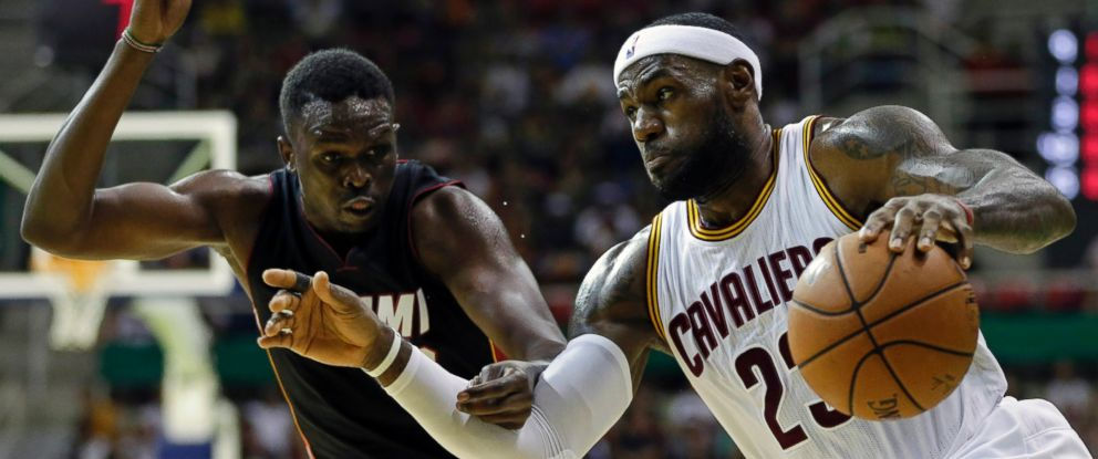 Cleveland Cavaliers LeBron James, right, drives past Miami Heats Luol Deng during an NBA preseason basketball game as part of the NBA Global Games, in Rio de Janeiro, Brazil, Oct. 11, 2014.