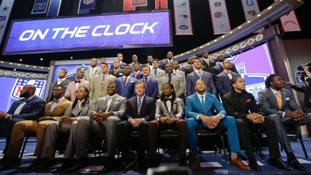 NFL draftees pose with commissioner Roger Goodell at the start of the 2014 NFL  Draft ada5f9968b1